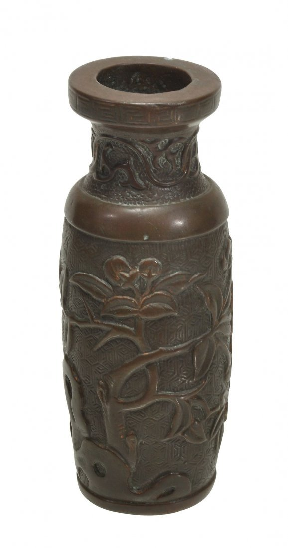 A small bronze cylindrical vase, Ming , decorated with