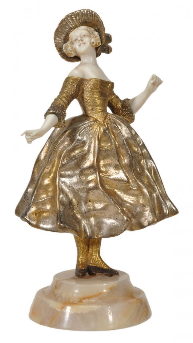Georges Omerth , a gilt and patinated bronze an ivory