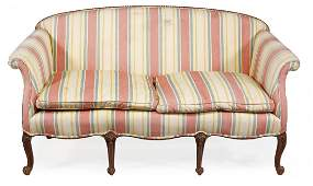A mahogany framed and upholstered settee in George III