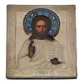A Russian icon of Christ Pantocrator in a silver and