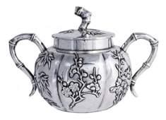 A Chinese export silver cream jug and sugar basin and