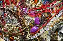 A collection of costume jewellery , including