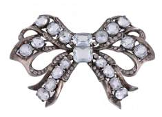 A ribbon bow costume brooch, set throughout with