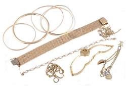 A collection of gold coloured jewellery , to include