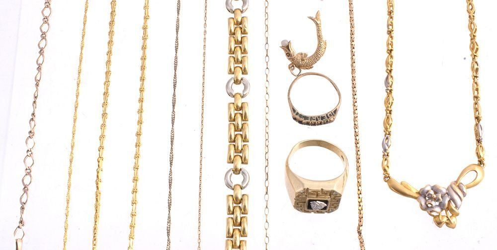 A collection of gold coloured jewellery; including
