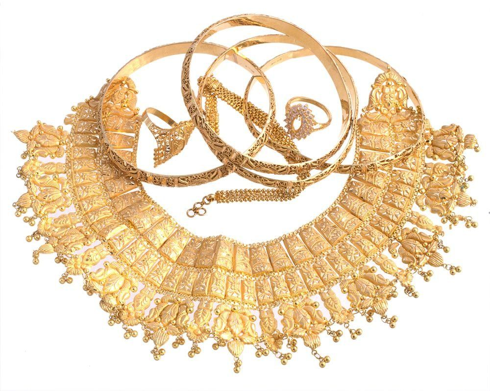 A collection of gold coloured jewellery , including