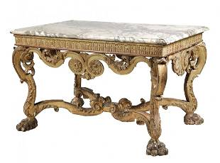 A George II carved giltwood and marble mounted console