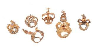Seven gold coloured miniature crowns, South American,