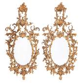 A pair of giltwood oval wall mirrors in George III