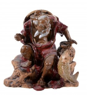 A Chinese Stoneware Figure Of A Fisherman, Glazed In