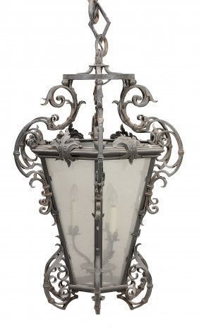 A Large Wrought Iron And Glazed Hanging Lantern In