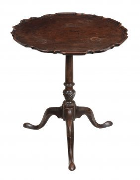A George Iii Mahogany Piecrust Tripod Table , Circa