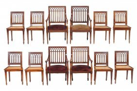 A Set Of Twelve Gothic Revival Mahogany Dining Chairs,