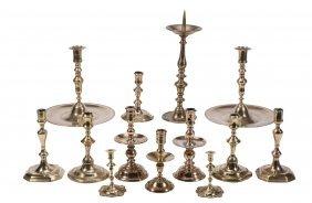 A Collection Of Thirteen Brass Candlesticks