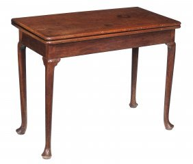 A George Ii Walnut Folding Card Table, Circa 1735, With