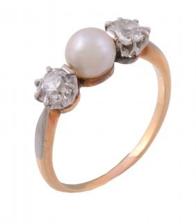 A Pearl And Diamond Ring, The Central Pearl Set Between