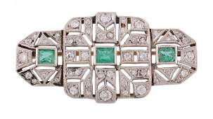 An Art Deco diamond and emerald brooch , circa 1930