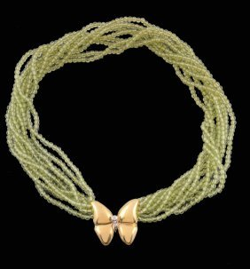 A Peridot Bead Necklace, Composed Of Polished Circular