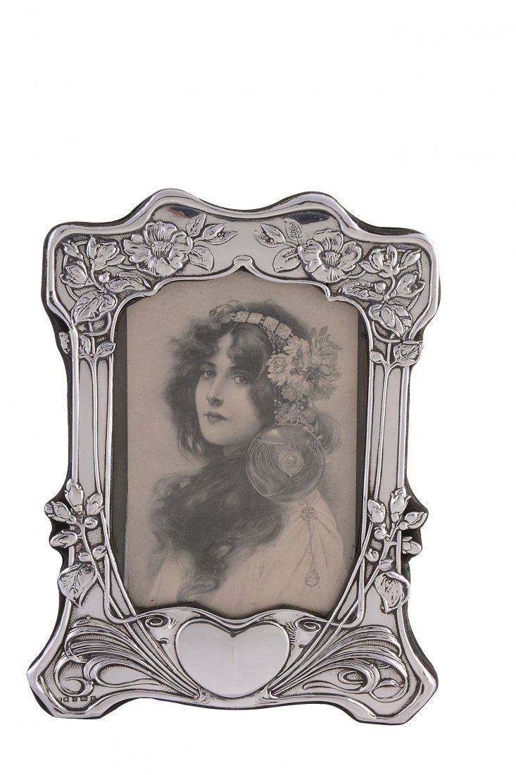 An Art Nouveau silver mounted photograph frame by H