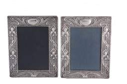 A pair of Art Nouveau silver mounted photograph frames