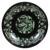 A large Chinese Famille Noire Charger 20th century
