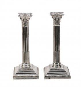 A Pair Of Edwardian Corinthian Column Candlesticks By
