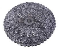 A South American silver mounted shaped circular mirror,