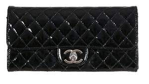 Chanel, Paris, a black patent quilted New Clutch bag