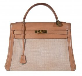 Hermes, A Tan Leather And Cream Canvas Vintage Kelly