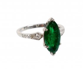 An Emerald And Diamond Dress Ring, The Marquise Cut