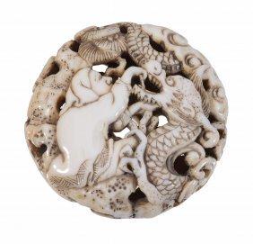 A Walrus Ivory Manju Of Typical Circular Form Pierced