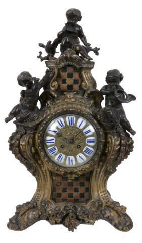 A French Bronze And Gilt Metal Mantel Clock In Louis