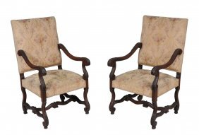 A Pair Of Carved Walnut And Upholstered Armchairs In