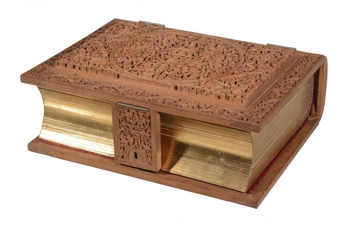 An Indian carved sandalwood photgraph album