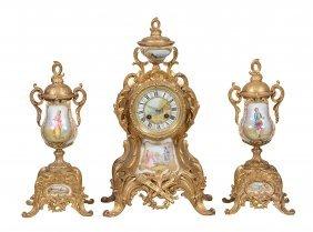 A Gilt-metal And Porcelain Clock Garniture De