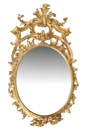 A Carved Giltwood Oval Wall Mirror In Mid 18th Century