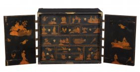 A Black Lacquer And Chinoiserie Decorated Cabinet ,