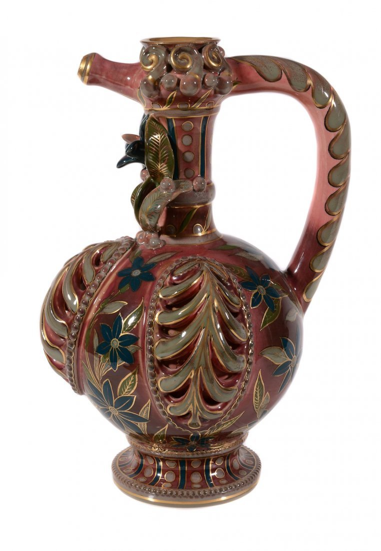 A Zsolnay Pecs ewer, circa 1880, decorated with
