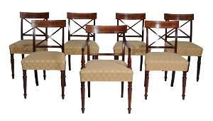 A set of seven Regency mahogany dining chairs , circa