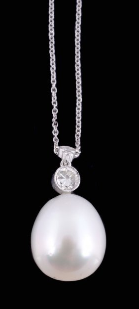 A Diamond And Cultured Pearl Pendant, The Ovoid