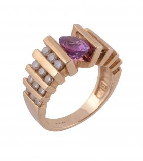 A Pink Sapphire And Diamond Dress Ring , The Oval Cut