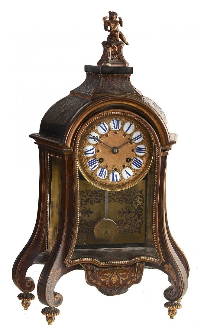 A gilt brass mounted Boulle table clock The case and