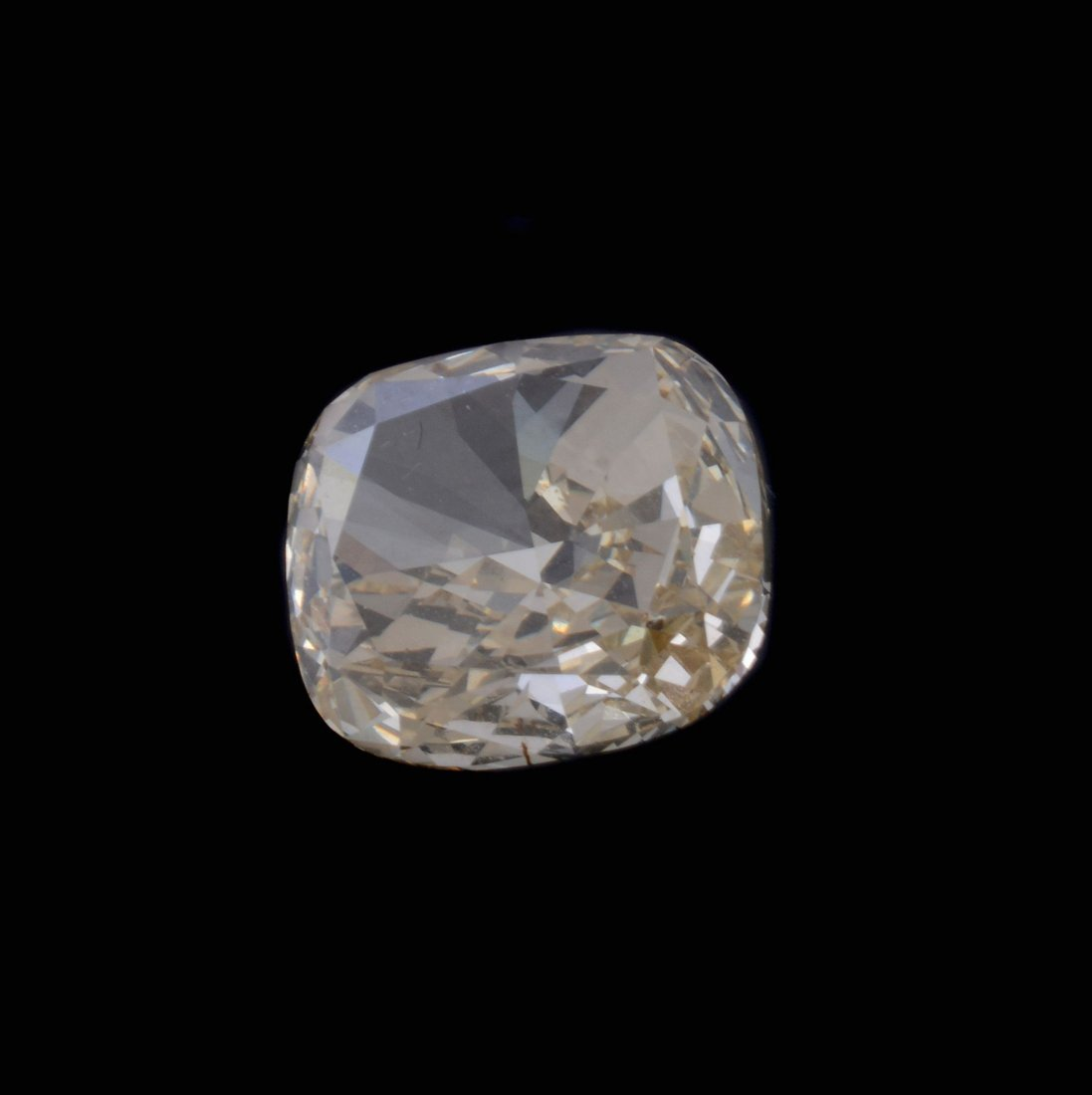 A loose cushion cut yellow diamond, weighing 3.00
