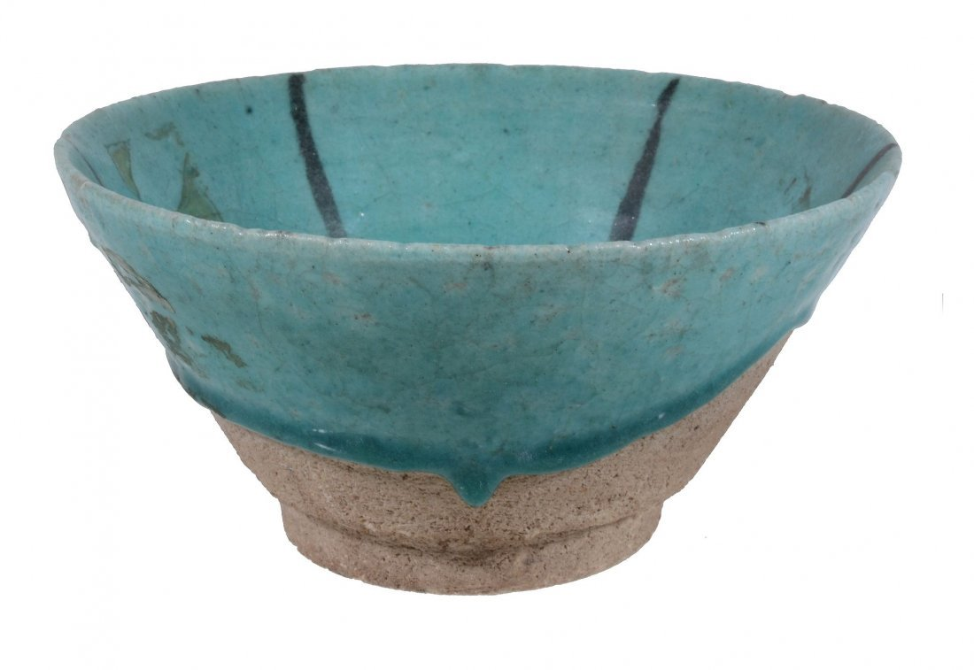 A Kashan Bowl, 12th Century, the heavily potted vessel