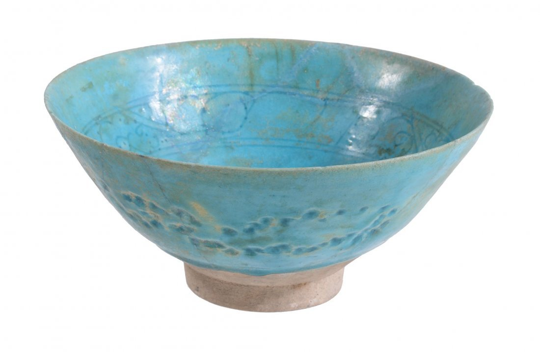 A Kashan Pottery Bowl, 12th Century, the conical bowl