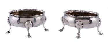 A pair of George III silver oval salt cellars by David