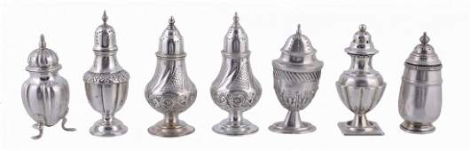 A pair of late Victorian silver pepperettes and five