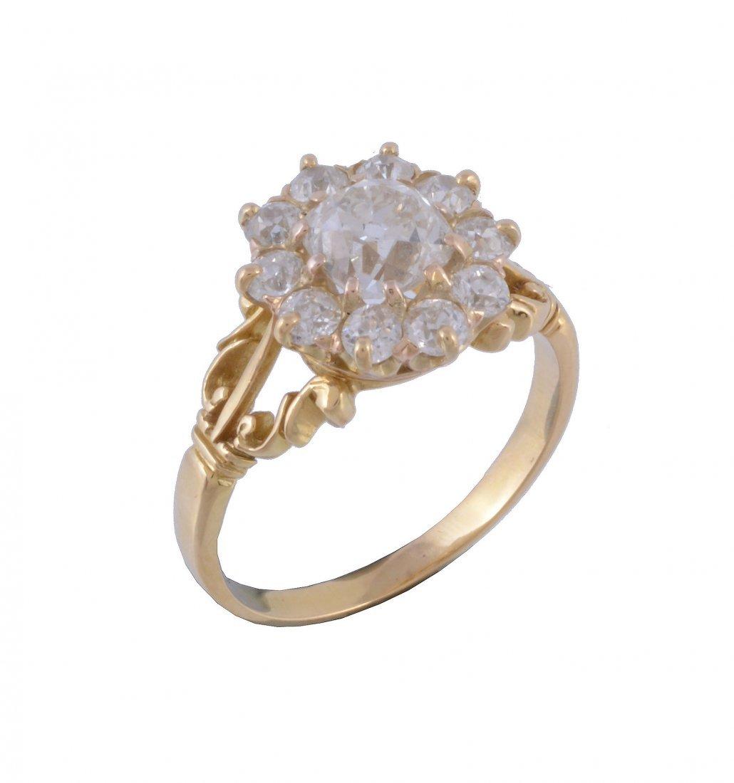 A diamond cluster ring, the central cushion cut diamond