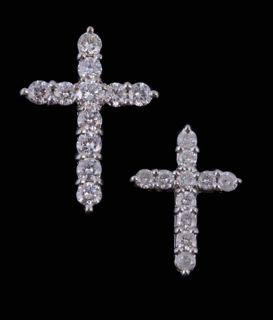 A diamond cross pendant, set with brilliant cut