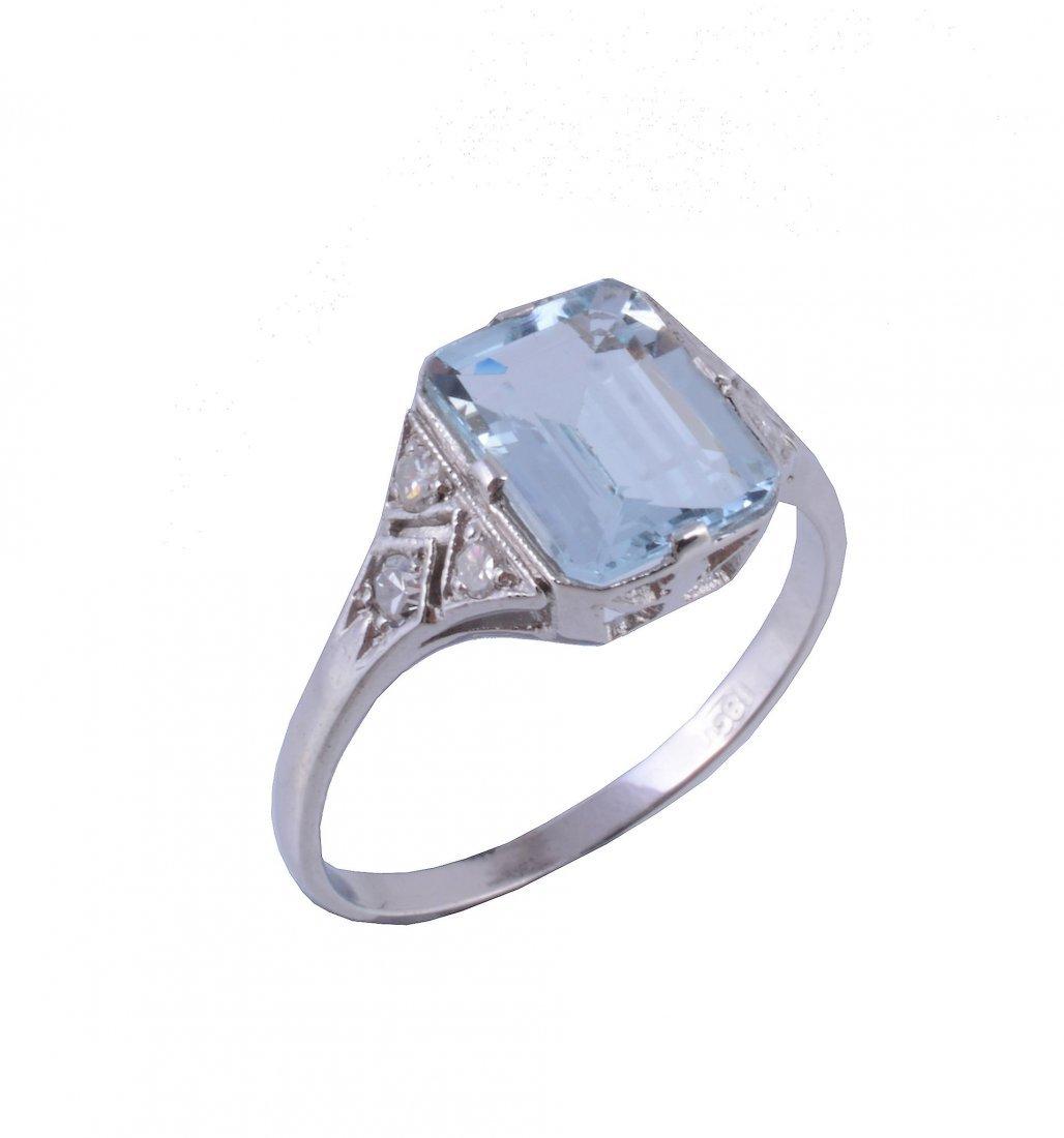 An aquamarine and diamond ring, the rectangular cut
